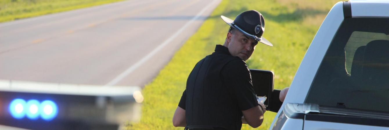 patrol officer pulling over truck