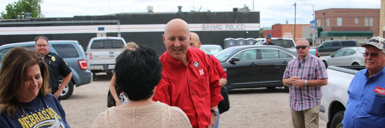 Governor Pete Ricketts shaking hands with group of people