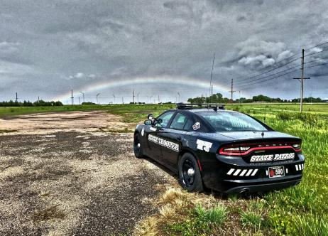 patrol vehicle with rainbow in distance
