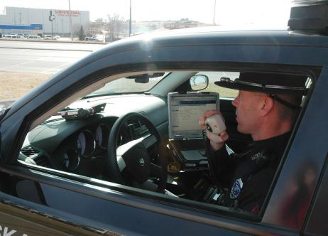 officer in patrol car talking on radio