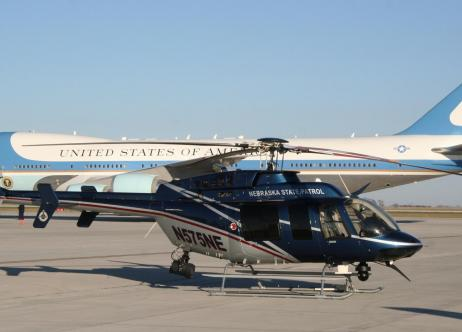 nebraska state patrol helicopter next to united states government airplane