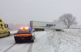 NSP cruiser responding to crash in the snow