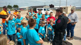 Officer meeting with a group of children
