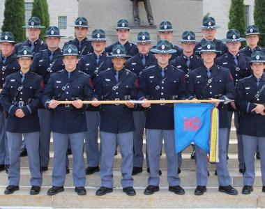 State patrol graduates in ceremonial uniforms